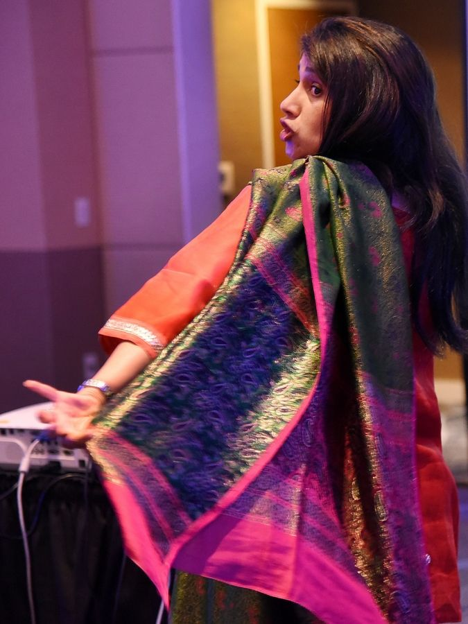 Seema Jain, director of Multicultural Affairs for Marriott International, demonstrates how to wear a sari.
