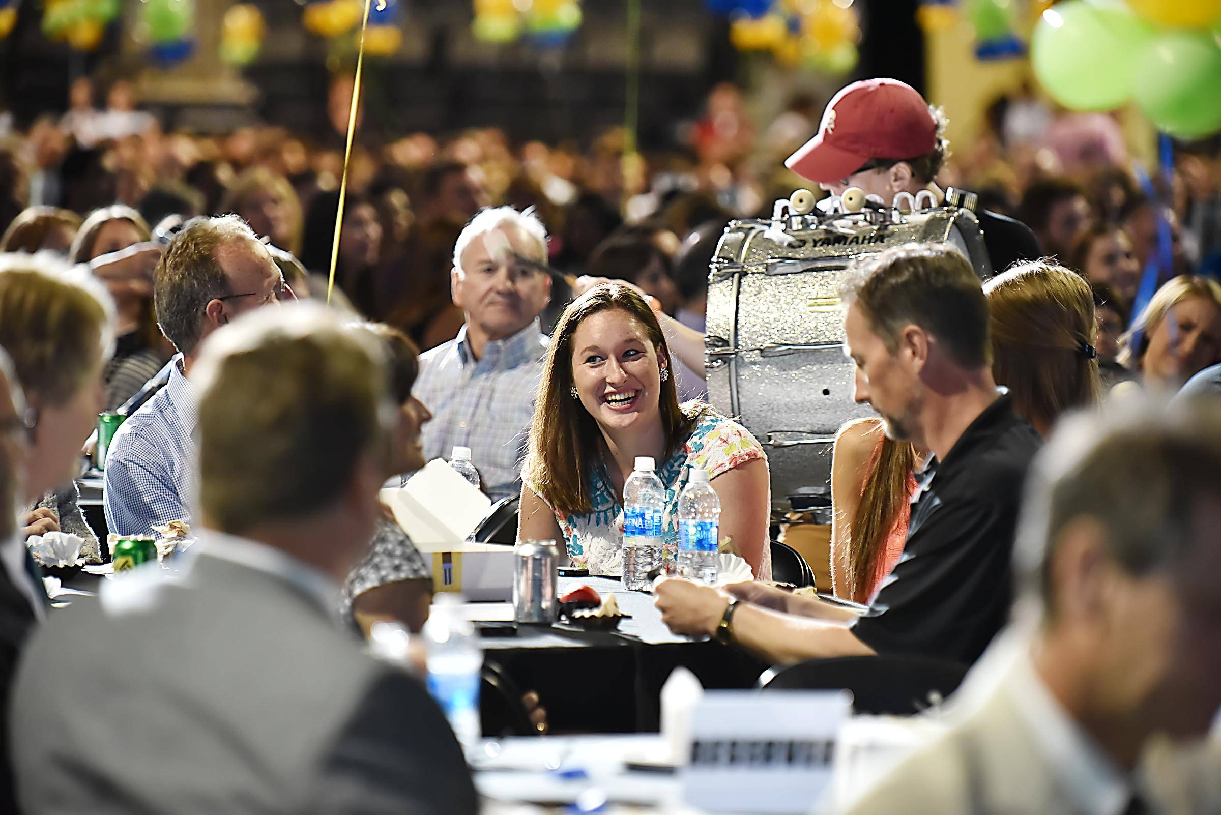 Katie Schroeder, of Grayslake Central High School laughs as a drummer plays close to her table during the Daily Herald Prep Sports Excellence Awards banquet at the Sears Centre Arena in Hoffman Estates Sunday.