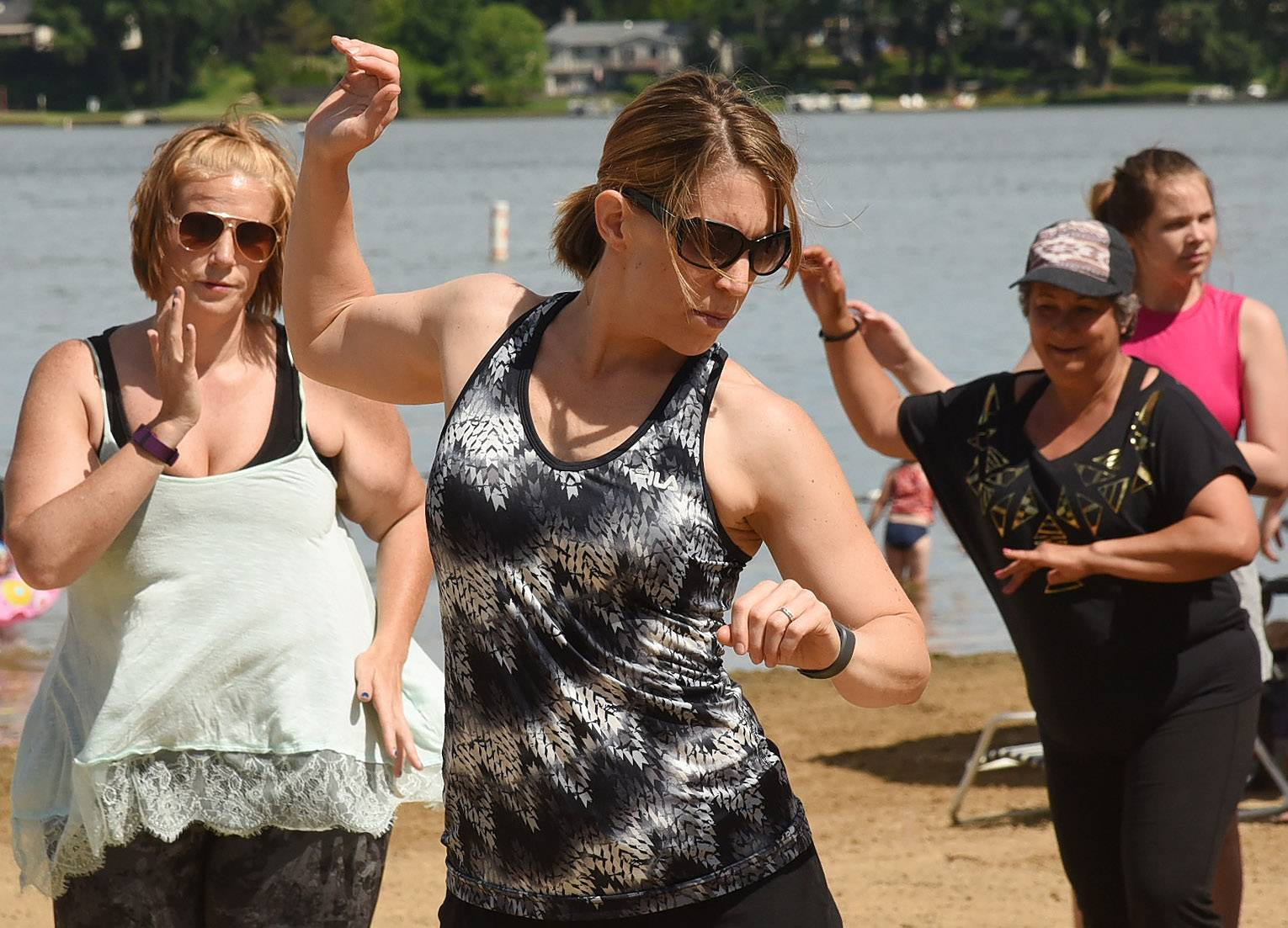 Marni Steinfort of Wauconda, a Saturday morning Zumba regular, takes it to the beach, during Mundelein Park & Recreation District's Community Picnic at Diamond Lake Beach.