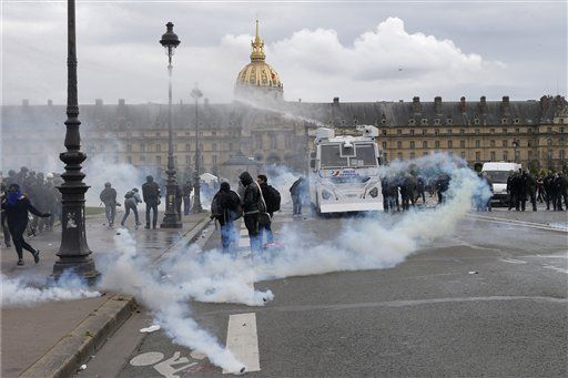Police use a water canon during a demonstration on the Place des Invalides in Paris, Tuesday, June 14, 2016. Protesters in Paris threw projectiles at police officers, who responded with tear gas, amid demonstrations by tens of thousands of people opposed to a proposed labor law.