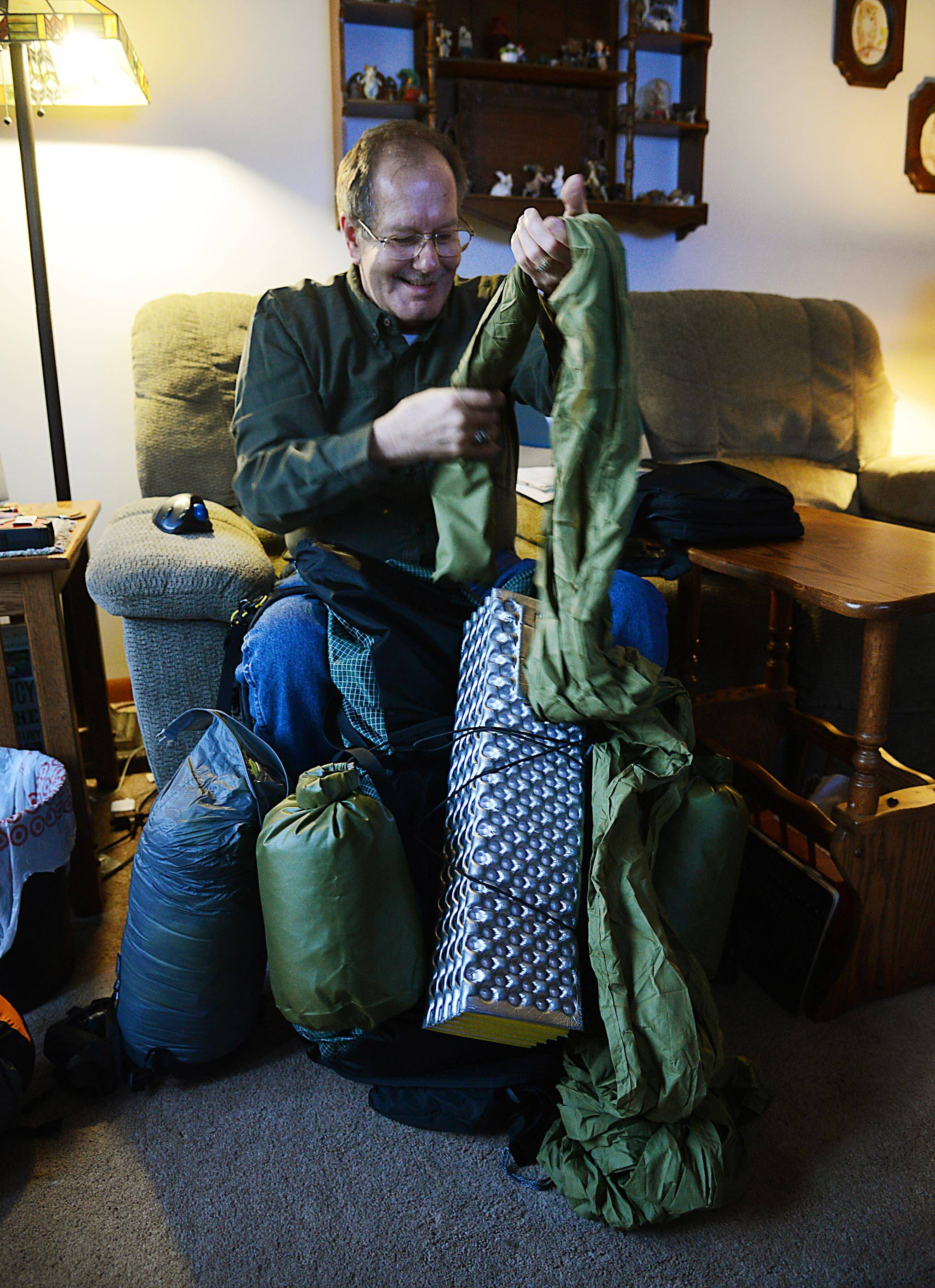 Bill Spence, pictured in February, shows some of the equipment he prepared for his Appalachian Trail hike.