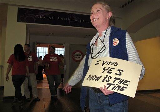 Shari Schugar, a cocktail server at the Tropicana casino, casts her ballot, Thursday, June 16, 2016, in Atlantic City, N.J., as members of Local 54 of the Unite-HERE union decide whether to authorize a strike against Bally's, Caesars, Harrah's, Tropicana casinos. The union has already authorized a strike against the Trump Taj Mahal. (AP Photo/Wayne Parry)