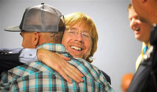 Lead singer of the national rock band, Phish, Trey Anastasio, hugs a graduate of a court drug rehabilitation program in Washington County Court in Ft. Edward, NY, Wednesday, June 15,2016. Anastasio is a past graduate of the same program. He told five new drug court graduates and a packed courtroom that the program put him on the road to nearly a decade of sobriety and likely saved his life. (Steve Jacobs/The Post-Star via AP)