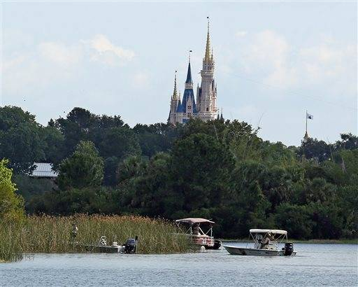 Law enforcement officials search the Seven Seas Lagoon outside the Grand Floridian Resort & Spa on Wednesday, June 15, 2016, in Lake Buena Vista, Fla., after a two-year-old toddler was dragged into the lake by an alligator.