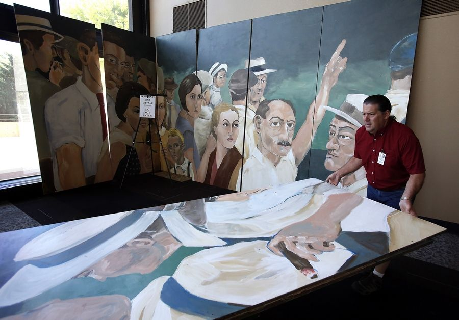 "Hemmens Cultural Center Director Butch Wilhelmi removed the ""American Nocturne"" mural from the center Friday morning to put it in storage. The controversial mural was inspired by a 1930 lynching photo."