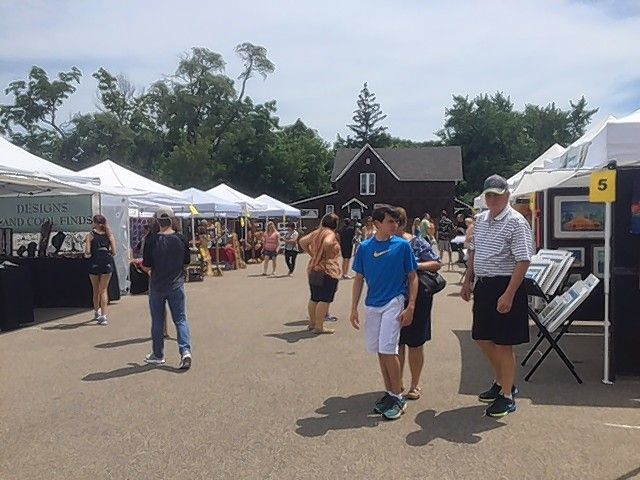 Attendees of Grayslake's 21st annual Arts Festival enjoyed strolling through 28 different vendors' booths, children's activities and live music. Bust organizers say some improvements are planned for next year to boost attendance.