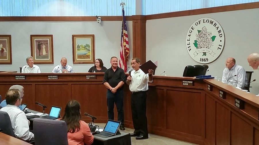 The Lombard village board recognized Fire Chief Paul DiRienzo for more than 30 years of service.