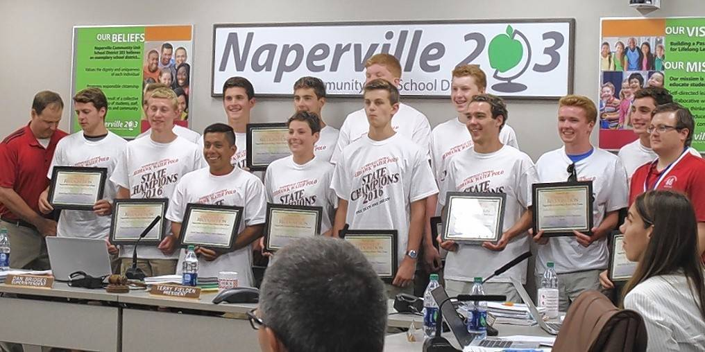 Members of the Naperville Central High School boys water polo team are recognized Monday night by the school board for winning the state championship.