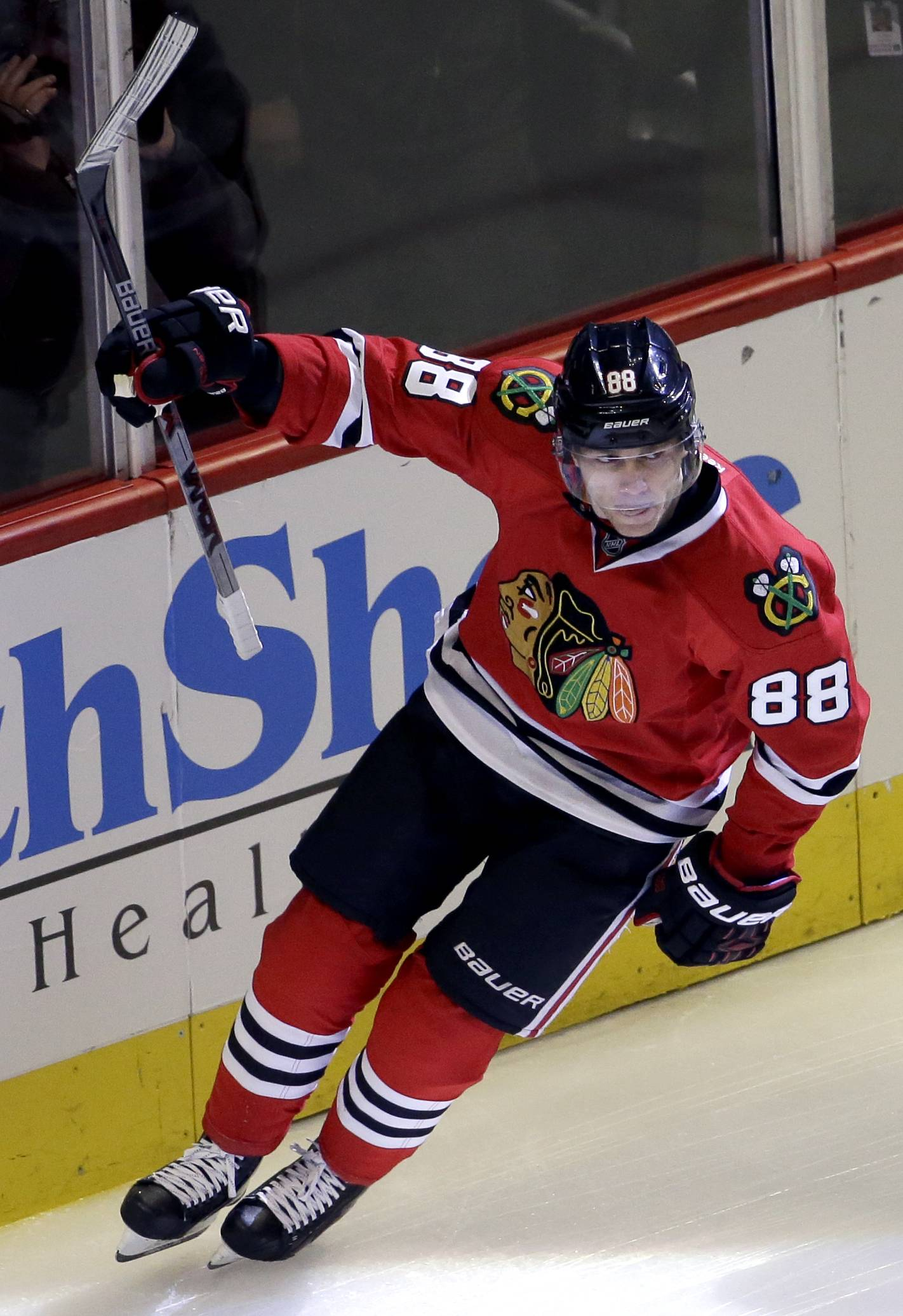 Chicago Blackhawks right wing Patrick Kane celebrates after scoring his goal during the first period of an NHL hockey game against the Detroit Red Wings Sunday, March 6, 2016, in Chicago.