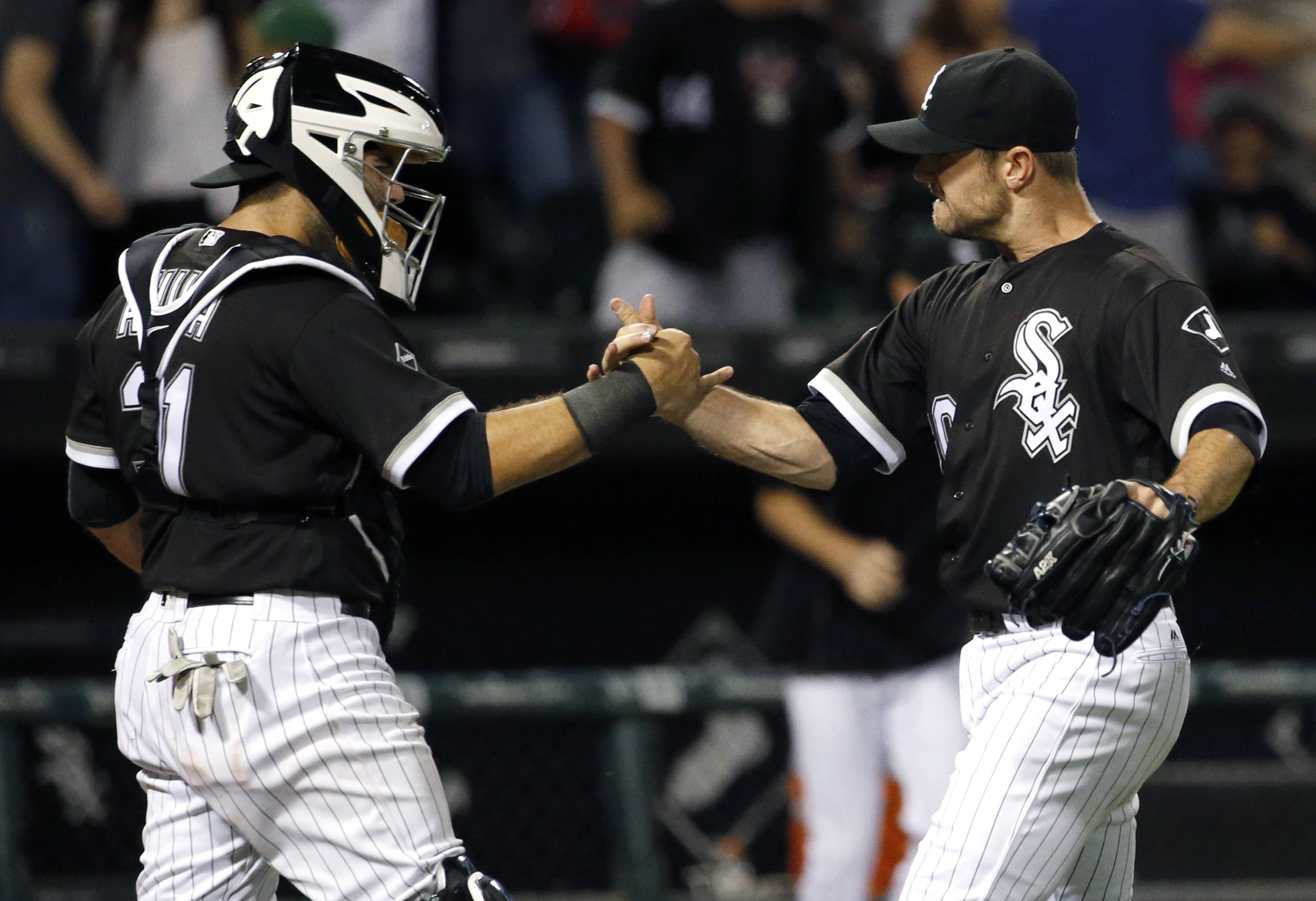Chicago White Sox closer David Robertson, right, celebrates with catcher Alex Avila after they defeated the Toronto Blue Jays in a baseball game in Chicago, Friday, June 24, 2016. (AP Photo/Nam Y. Huh)