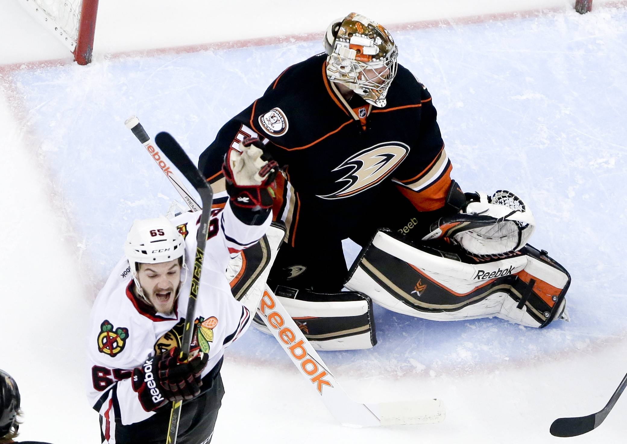 Chicago Blackhawks center Andrew Shaw, left, celebrates after scoring against Anaheim Ducks goalie Frederik Andersen during the first period of Game 2 of the 2015 Western Conference finals.