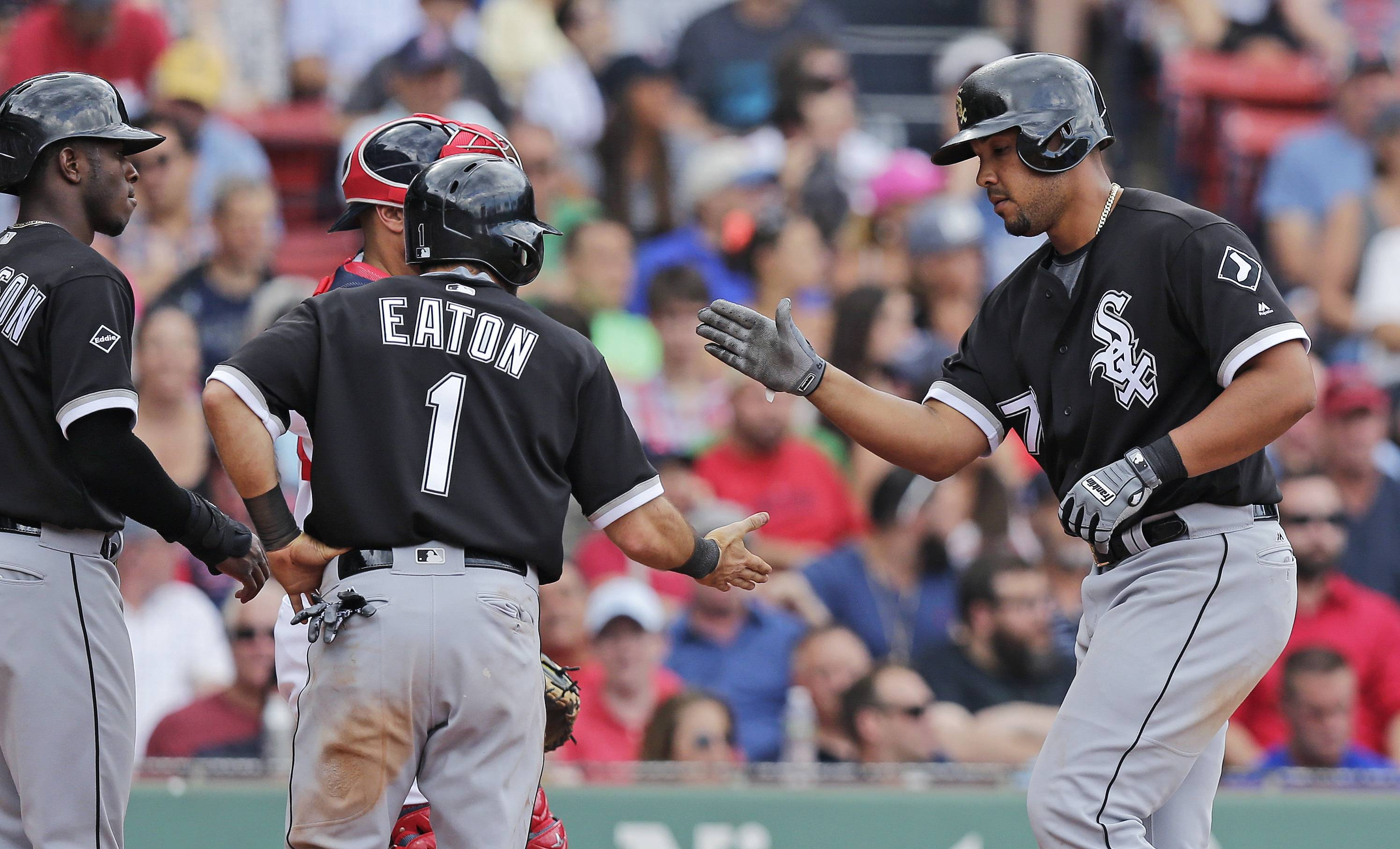 Chicago White Sox's Jose Abreu, right, is congratulated after his three-run home run off Boston Red Sox relief pitcher Junichi Tazawa during the seventh inning of a baseball game at Fenway Park, Thursday, June 23, 2016, in Boston. (AP Photo/Charles Krupa)
