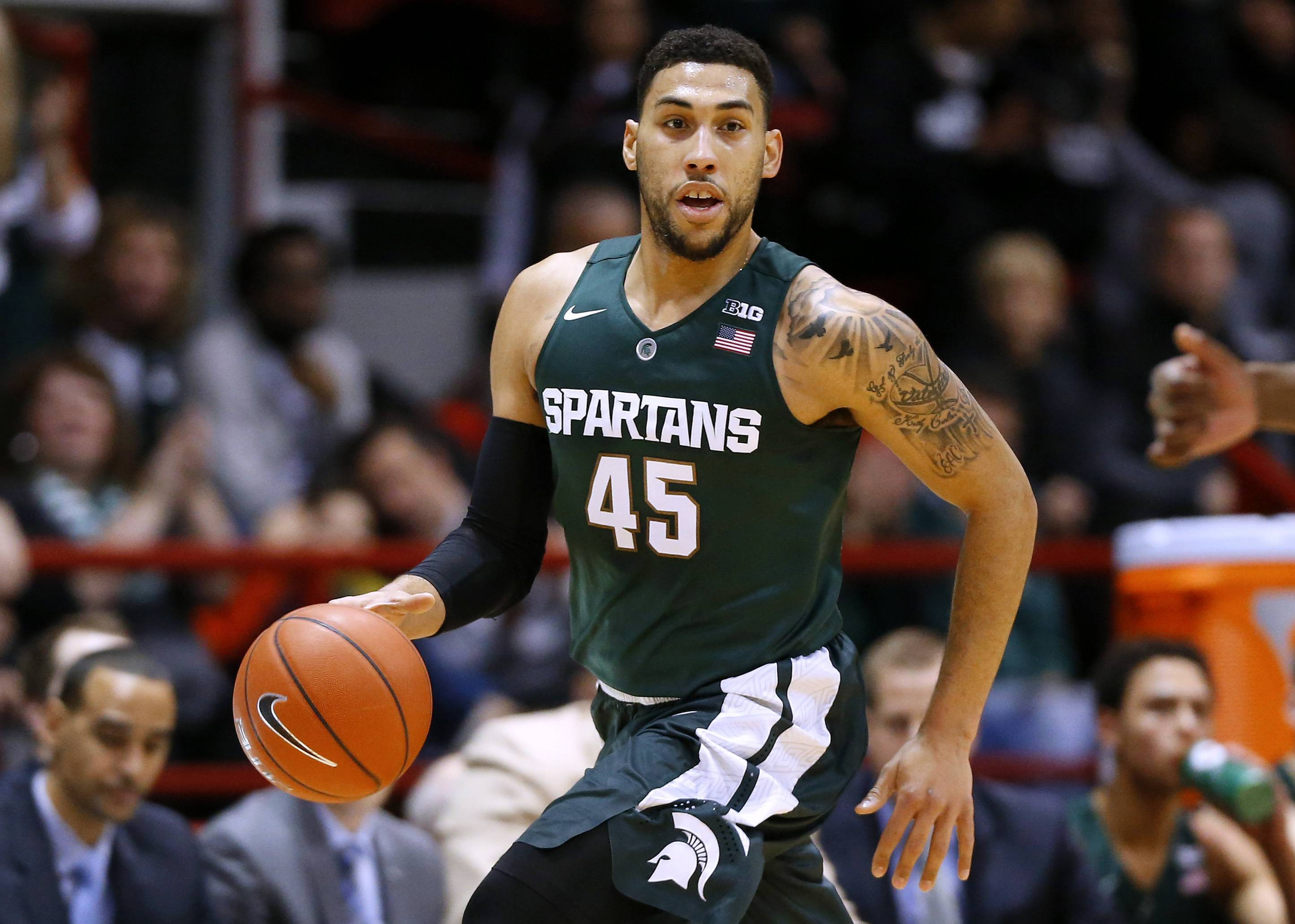 FILE — In this Dec. 19, 2015, file photo, Michigan State's Denzel Valentine brings the ball upcourt during an NCAA college basketball game against Northeastern in Boston. Valentine worked out for the Utah Jazz just under two weeks ago and that was the first of four scheduled workouts, along with the Bulls, Bucks and Magic. The Michigan State guard explained that his agent had identified the Jazz as a potential landing spot. He's expected to go anywhere from late lottery to the late 20s. (AP Photo/Winslow Townson, File)