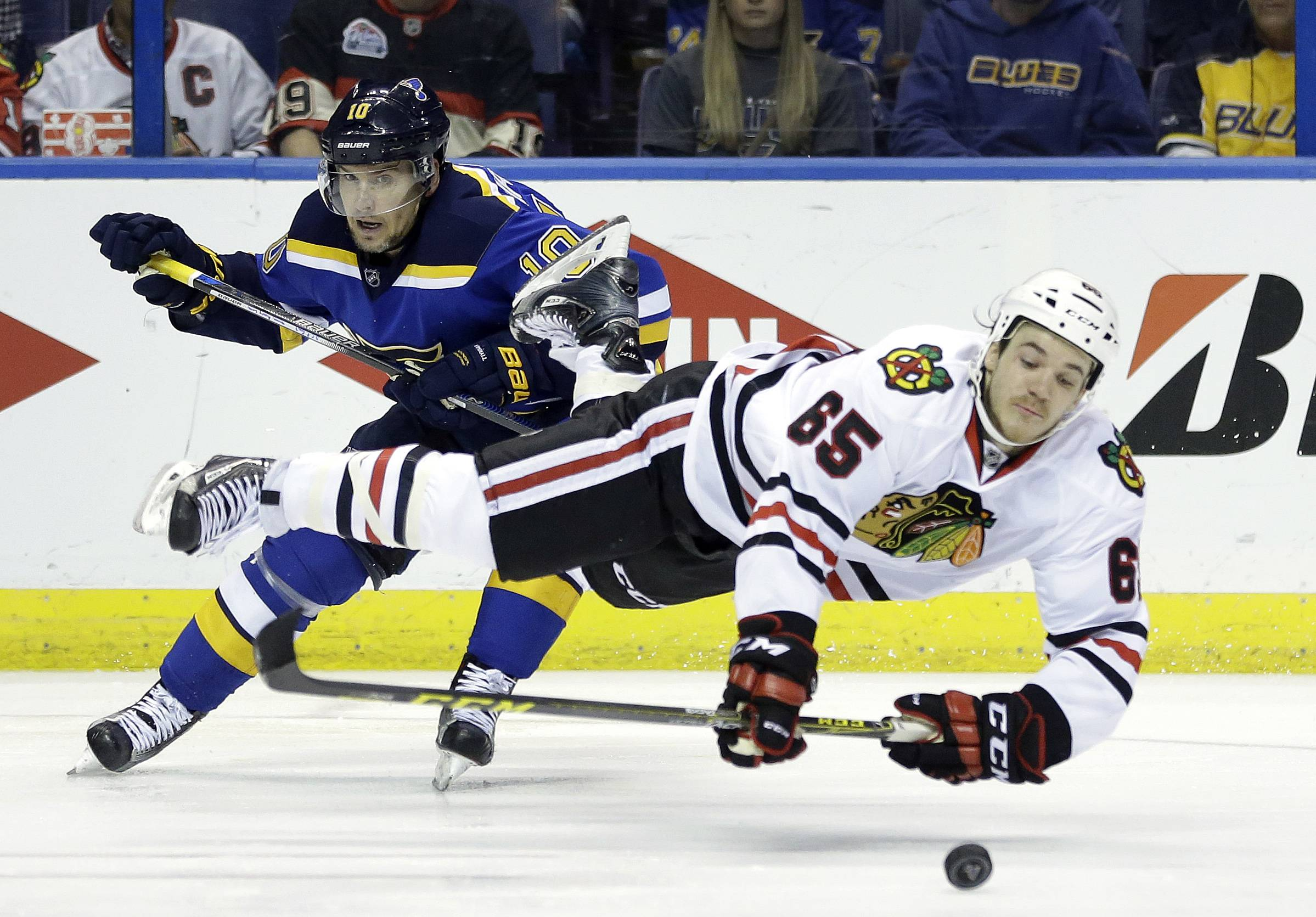 Andrew Shaw, sent flying after colliding with St. Louis Blues' Scottie Upshall while reaching for a puck during Game 7 of the first round of this year's Stanley Cup playoffs series Monday, was traded Friday by the Chicago Blackhawks to the Montreal Canadiens for two draft picks. (AP Photo/Jeff Roberson)