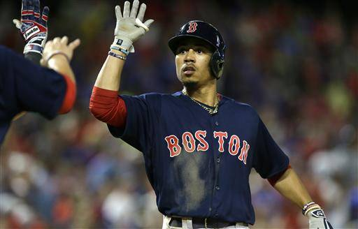 Boston Red Sox's Mookie Betts celebrates his home run during the ninth inning of a baseball game against the Texas Rangers in Arlington, Texas, Friday, June 24, 2016. The Red Sox won 8-7. (AP Photo/LM Otero)