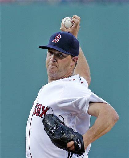 Boston Red Sox starting pitcher Steven Wright winds up during the first inning of a baseball game against the Chicago White Sox at Fenway Park, Monday, June 20, 2016, in Boston. (AP Photo/Charles Krupa)