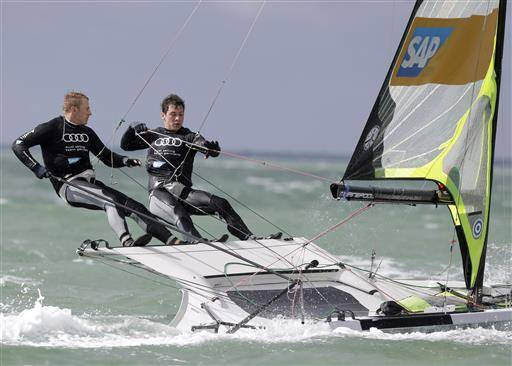 FILE - In this Jan. 26, 2015 file photo, Erik Heil, left, and Thomas PloBel, right, of Germany, compete in the 49er class during the ISAF Sailing World Cup Miami on Biscayne Bay, in Miami. Heil was hospitalized in Berlin and underwent surgery to treat inflammation and skin infections after competing in polluted water at a test event in August for the Rio de Janeiro Olympics. (AP Photo/Lynne Sladky, File)