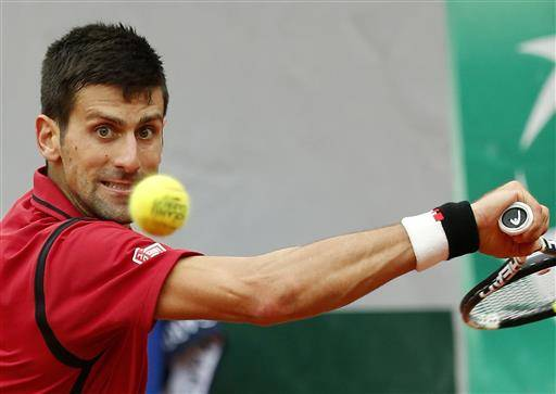 FILE - In this June 5, 2016 file photo, Serbia's Novak Djokovic returns the ball to Britain's Andy Murray during their final match of the French Open tennis tournament at the Roland Garros stadium in Paris. (AP Photo/Alastair Grant, file )