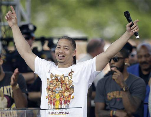 Cleveland Cavaliers head coach Tyronn Lue acknowledges the crowd as he speaks at a rally, Wednesday, June 22, 2016, in Cleveland. The Cavaliers made history by overcoming a 3-1 deficit to beat the Golden State Warriors in the NBA Finals and end the city's 52-year drought without a professional sports championship. (AP Photo/Tony Dejak)
