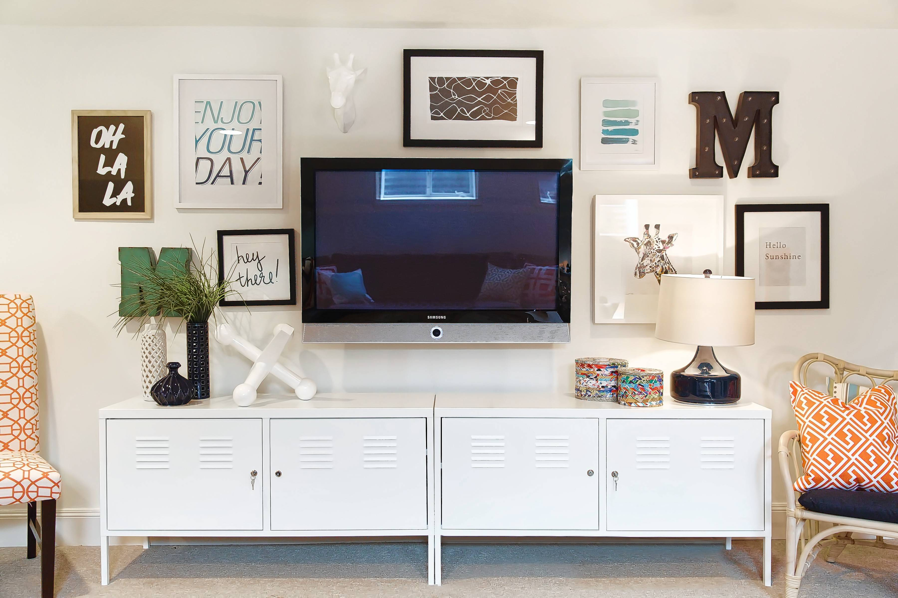 Making your TV part of a gallery wall will lessen its visual impact on the room's design.
