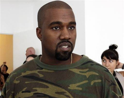 "FILE - In this Sept. 10, 2015 file photo, Kanye West appears at the Brother Vellies Spring 2016 collection presentation during Fashion Week, in New York. West has unveiled a video that is all about a subject he knows something about: fame. The video for a single titled ""Famous"" unveiled Friday, June 24, 2016, at a promotional event in the Los Angeles Forum _ features what appears to be a naked West with images of 11 other famous people, some of whom he has had good and bad relationships with, Vanity Fair magazine reported. The celebrities, who appear to be naked in a huge bed with West, are his wife, Kim Kardashian West; former President George W. Bush; presumptive Republican presidential nominee Donald Trump; Vogue editor Anna Wintour; singers Rihanna, Chris Brown and Taylor Swift; producer Ray J.; former girlfriend Amber Rose; transgender activist Caitlyn Jenner; and comedian Bill Cosby. (AP Photo/Richard Drew, File)"