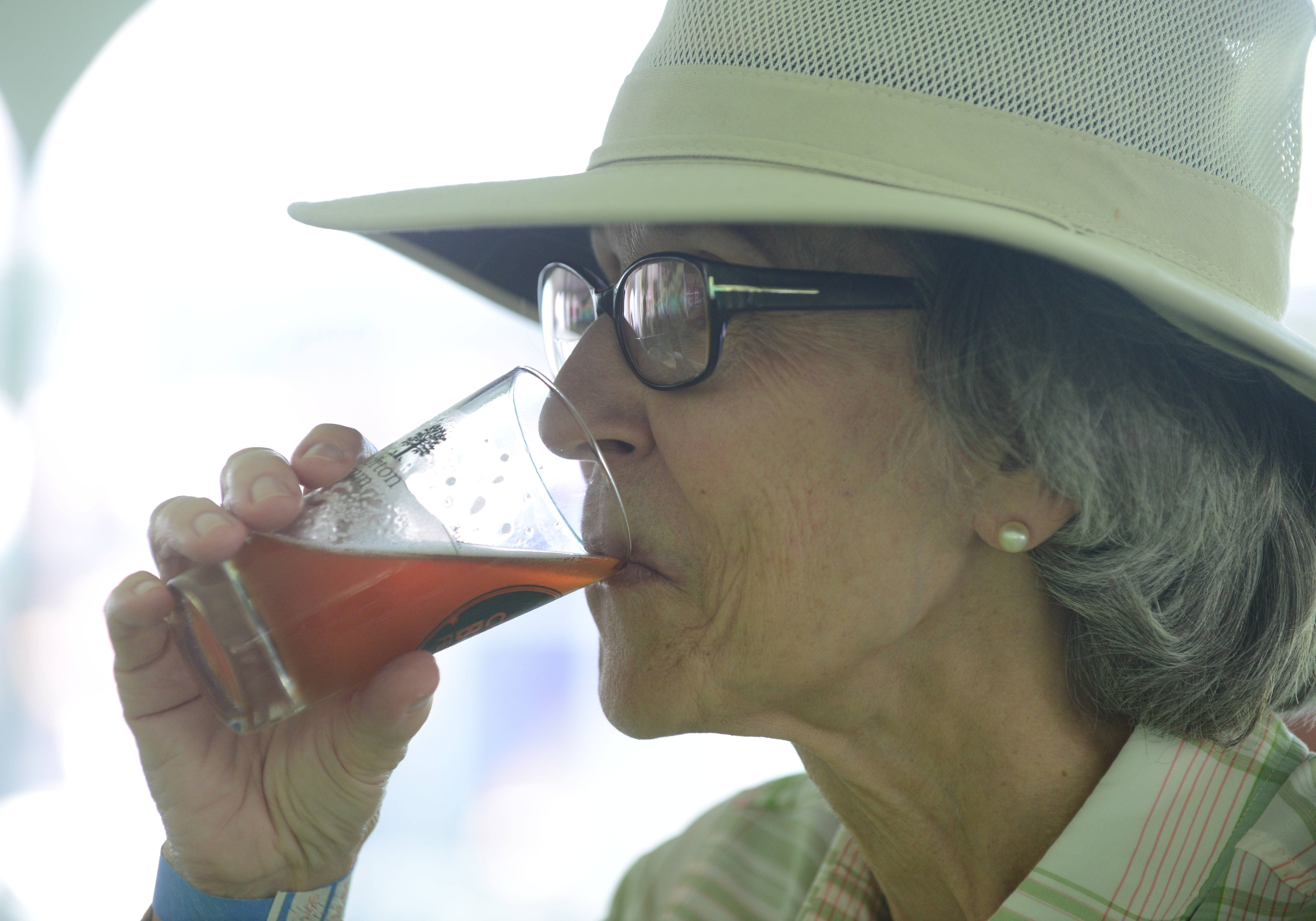 Mary McLeod of Lombard sips a Red Handed Irish Ale by Banging Gavel Brews during the Morton Arboretum's Craft Beer Festival Arboretum Saturday. More than 50 beers were on tap.