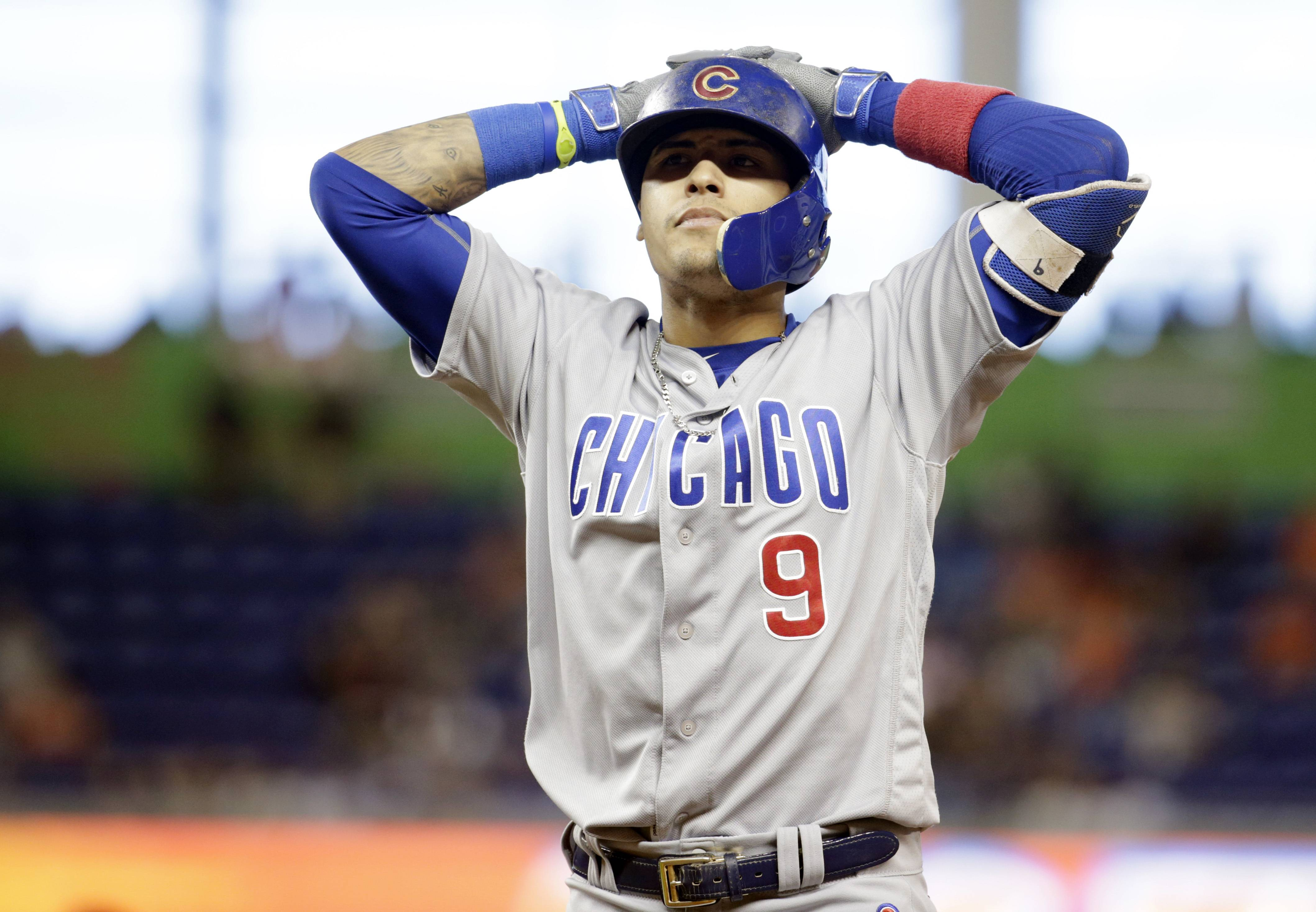 Chicago Cubs' Javier Baez (9) reacts after flying out to Miami Marlins shortstop Adeiny Hechavarria during the ninth inning of a baseball game, Saturday, June 25, 2016, in Miami. The Marlins defeated the Cubs 9-6. (AP Photo/Lynne Sladky)