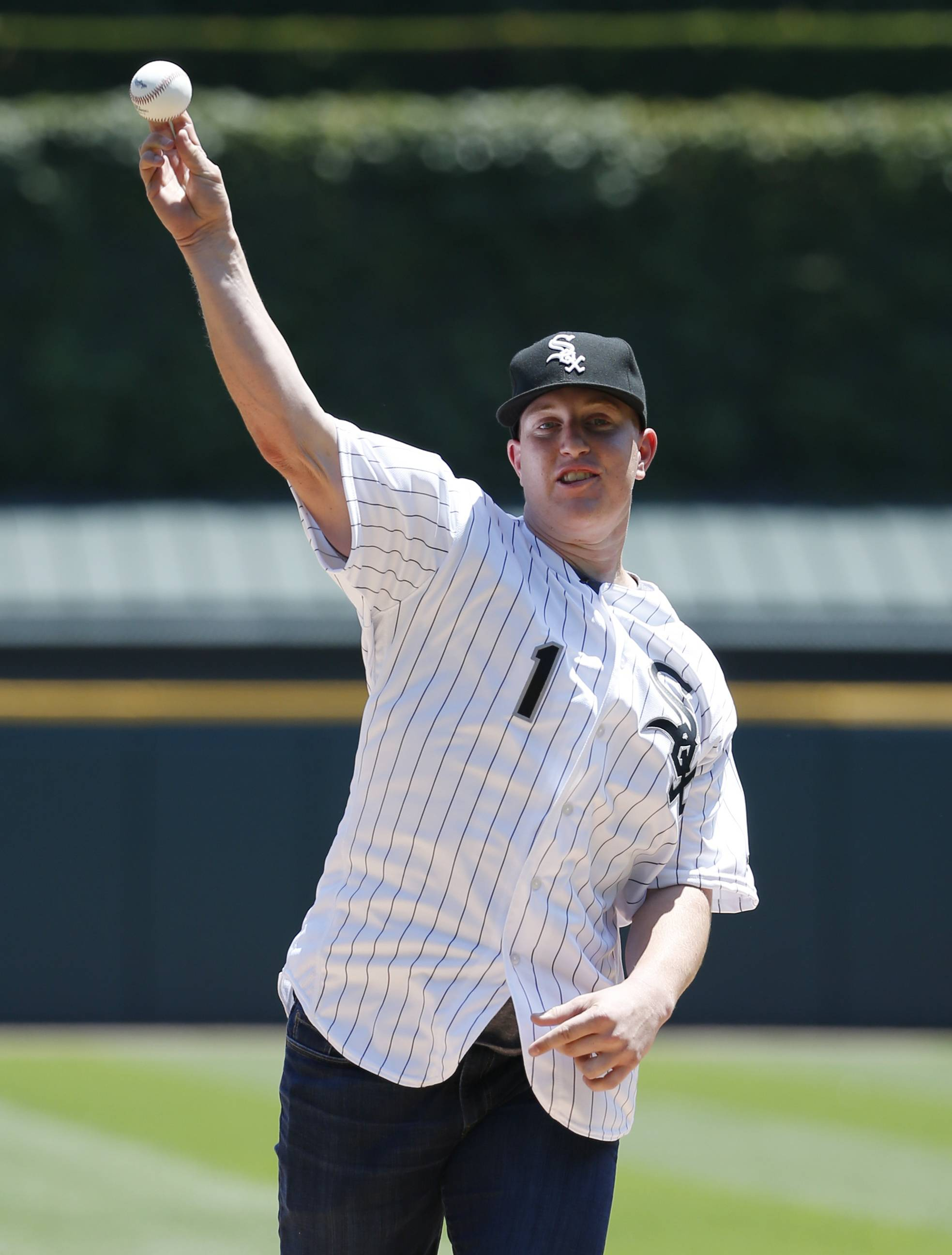 Chicago White Sox's first-round draft pick Zack Collins throws out the ceremonial first pitch before Saturday's game against the Toronto Blue Jays in Chicago. Collins signed his minor league contract Friday, and is set to report to the Arizona League White Sox in July.