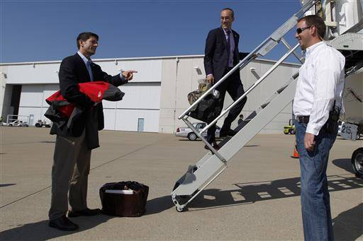 FILE - In this Oct. 12, 2012 file photo, then-Republican vice presidential candidate, Rep. Paul Ryan, R-Wis., left, speaks to senior adviser Dan Senor, center, and trip director Brent Swander before boarding the campaign charter flight at the Louisville International airport, in Louisville, Ky. Donald Trump knows his bare-bones staff must grow, but many experienced GOP operatives are refusing to sign up, citing personal and professional concerns about the candidate and his turbulent organization. (AP Photo/Mary Altaffer, File)