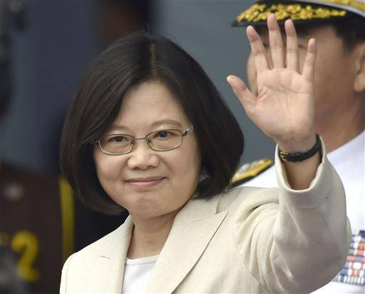 FILE - In this May 20, 2016 file photo, Taiwan's Tsai Ing-wen waves at the venue of her inauguration at the Presidential Office Building in Taipei, Taiwan. Beijing says contact between the main China-Taiwan liaison bodies has been cut because of President Tsai Ing-wen's failure to endorse the concept of a single Chinese nation. The statement posted on the website of the Cabinet's Taiwan Affairs Office came on Saturday, June 25, 2016, after Taiwan protested Cambodia's deportation of 25 Taiwanese internet scam suspects to China. (Minoru Iwasaki/Kyodo News via AP, File) JAPAN OUT, CREDIT MANDATORY