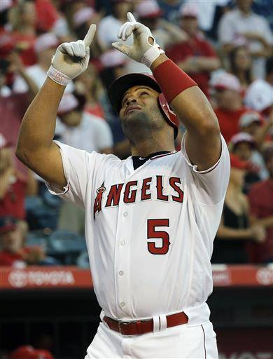 wbbLos Angeles Angels designated hitter Albert Pujols points skyward after hitting a two-run home run against the Oakland Athletics during the first inning of a baseball game in Anaheim, Calif., Friday, June 24, 2016. (AP Photo/Alex Gallardo)