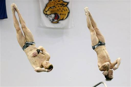 Steele Johnson, left, and David Boudia dive in the synchronized men's 10-meter platform final at the U.S. Olympic diving trials Thursday, June 23, 2016, in Indianapolis. The pair won the competition. (AP Photo/AJ Mast)