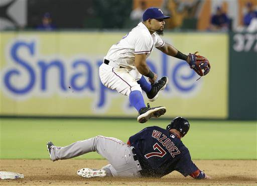 Texas Rangers second baseman Rougned Odor jumps as Boston Red Sox Christian Vazquez (7) slides into second base after being forced out on the first half of a double play during the fifth inning of a baseball game in Arlington, Texas, Friday, June 24, 2016. Mookie Betts was out at first (AP Photo/LM Otero)