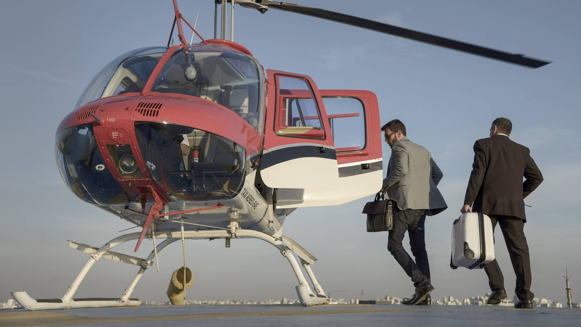 A passenger prepares to board an UberCopter.