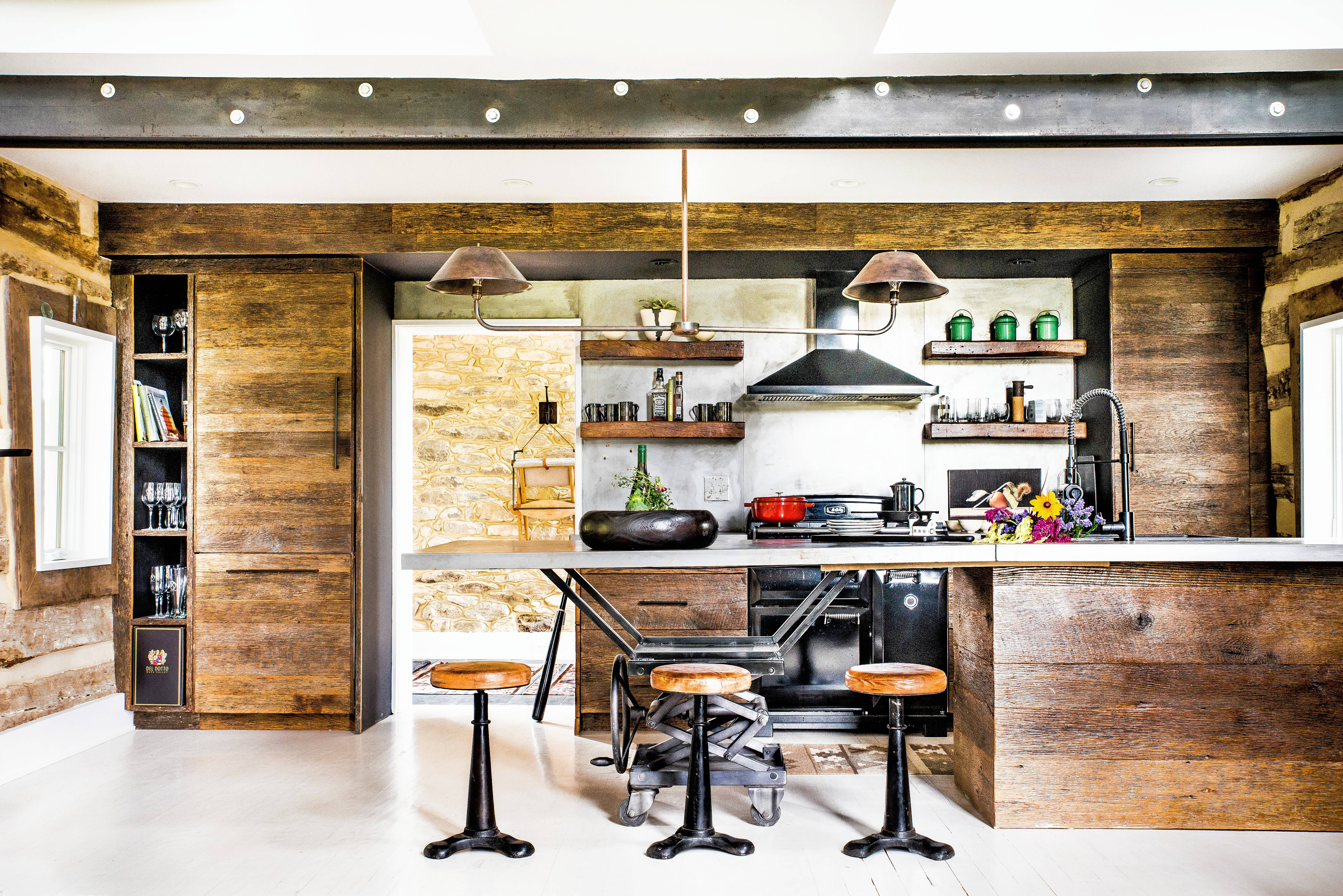 Charleston interior designer Cortney Bishop relied on a palette of stone, metal and wood and lots of black paint to turn this Round Hill, Virginia, relic into a posh escape.