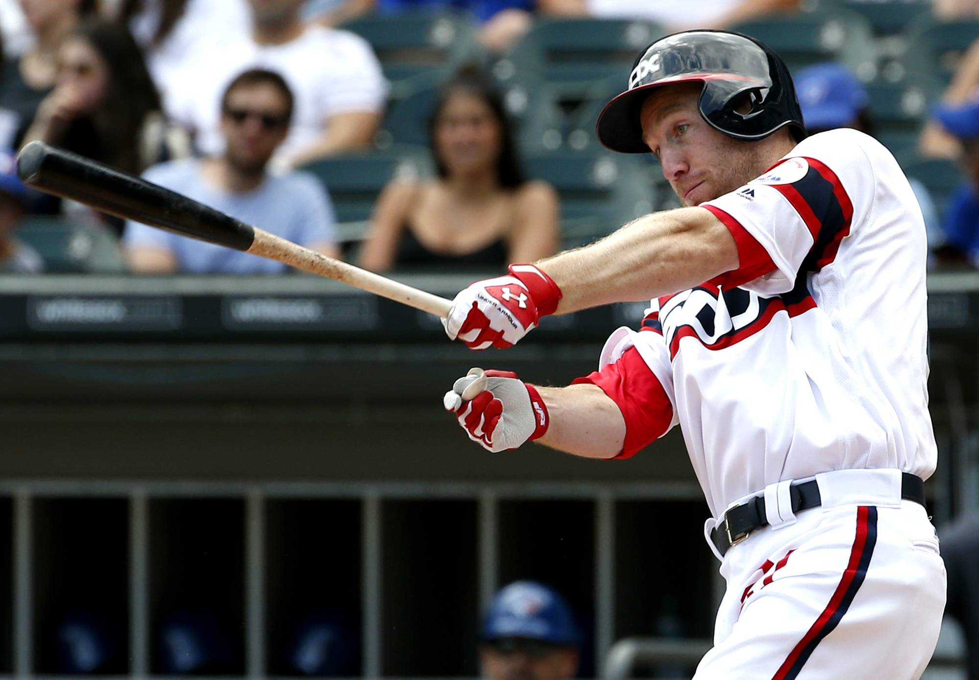 White Sox's Todd Frazier hits a single against the Toronto Blue Jays during the second inning of a baseball game in Chicago, Sunday.