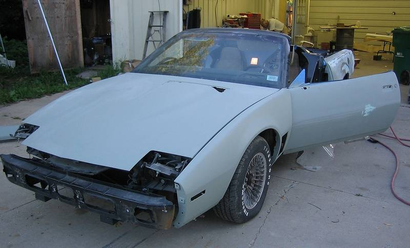 Meet the cop whos a knight rider fan with his own kitt car eric wangs 1983 pontiac firebird trans am is shown in the early stages of being rebuilt mozeypictures Images