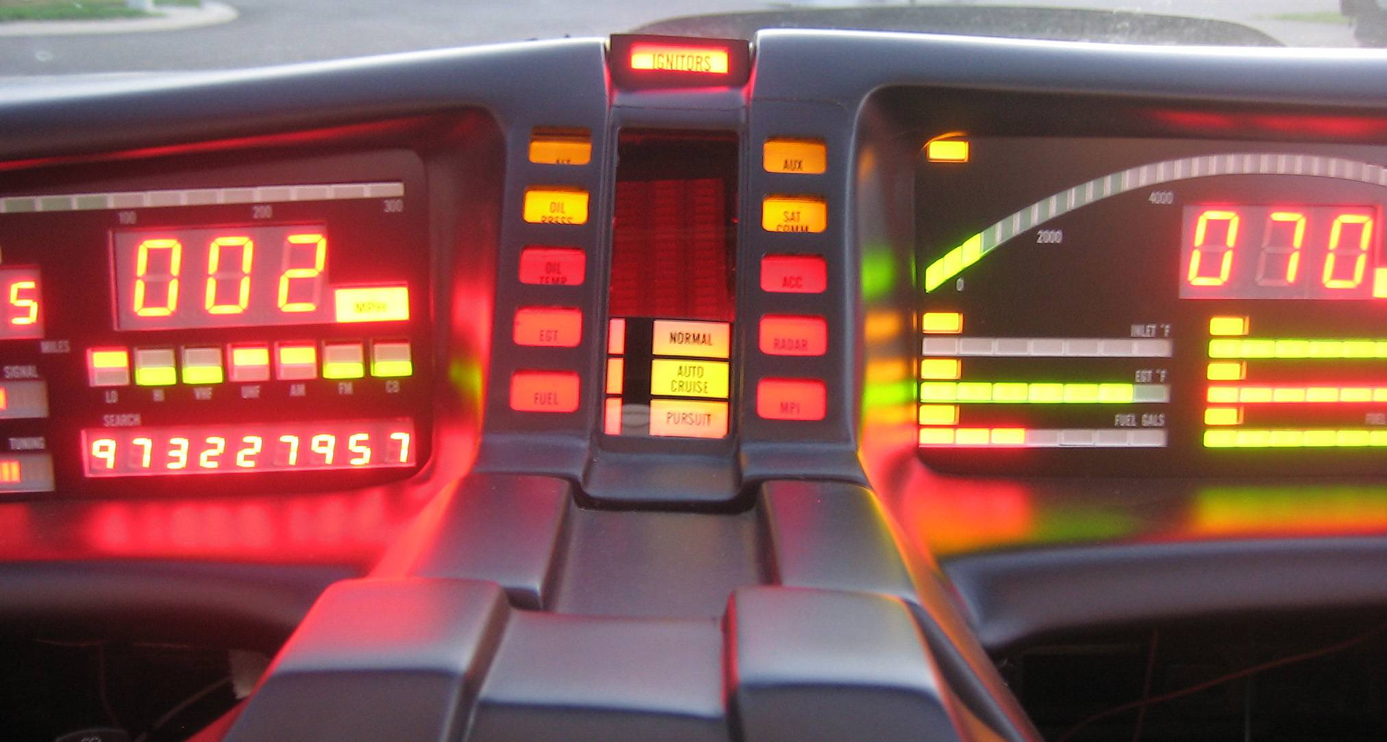 "Eric Wang's 1983 Pontiac Firebird Trans Am ""KITT car"" sits with its custom dashboard glowing after many months of rebuilding."