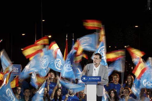Spain's acting Prime Minister and Popular Party candidate Mariano Rajoy gives a speech during the campaign closing rally in Madrid, Friday, June 24, 2016. Spaniards are voting in a general election Sunday, just six months after a last unsuccessful attempt to pick a new government. (AP Photo/Daniel Ochoa de Olza)