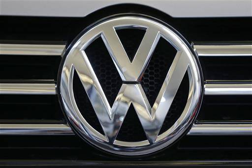 FILE - In this Feb. 14, 2013, file photo, the Volkswagen logo is seen on the grill of a Volkswagen on display in Pittsburgh. Volkswagen would repair or buy back polluting vehicles and pay each owner as much as $10,000 under a $14.7 billion deal the car maker has reached to settle lawsuits stemming from its emissions cheating scandal, a person briefed on the settlement talks said Monday, June 27, 2016. (AP Photo/Gene J. Puskar, File)