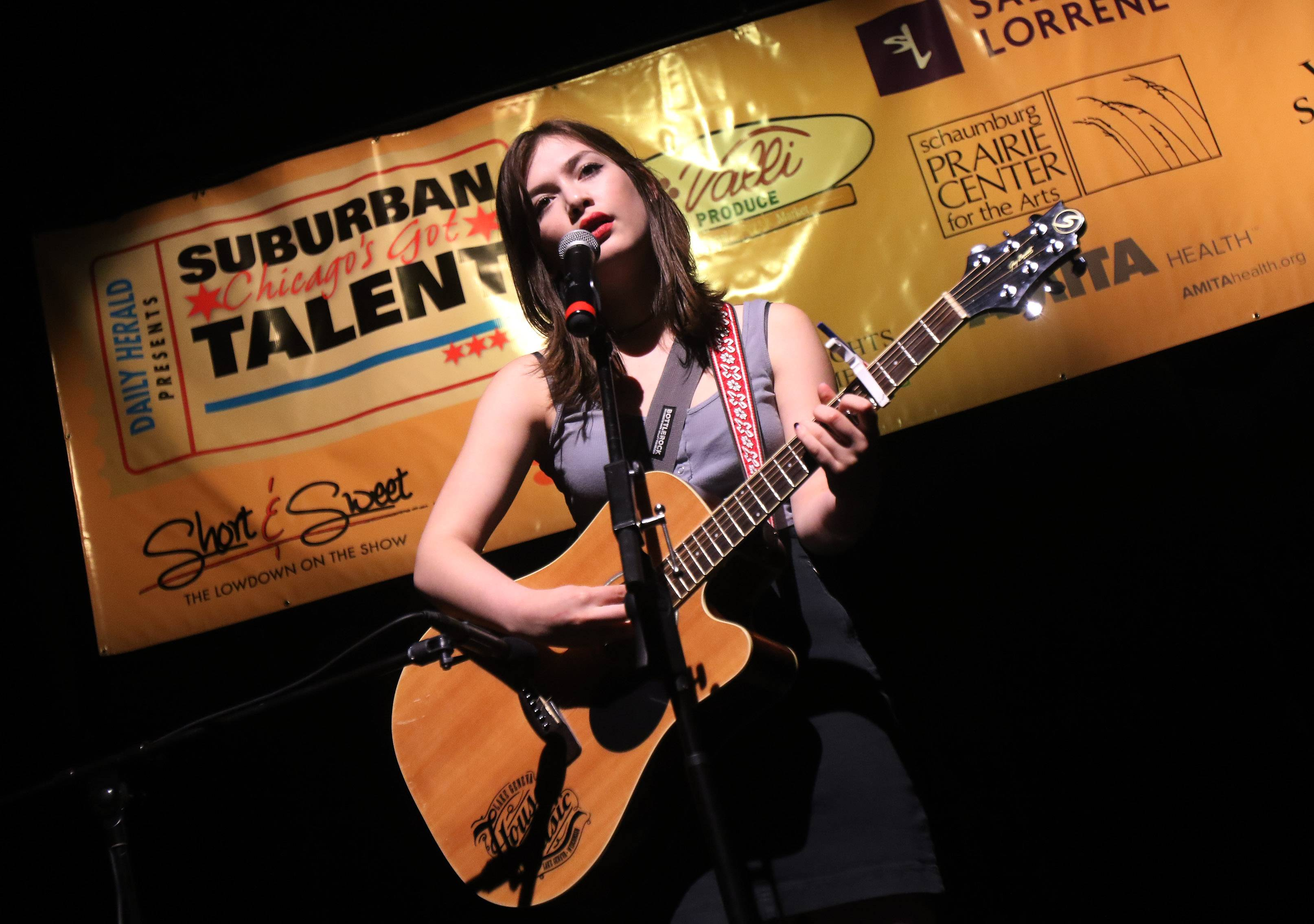 Rhea of Richmond sings as she plays guitar during the Suburban Chicago's Got Talent for 2016 competition at the Prairie Center for the Arts in Schaumburg. The winner of the final contest wins a STARter kit worth $5,000 with a chance to be an opening act at the Arcada Theatre.