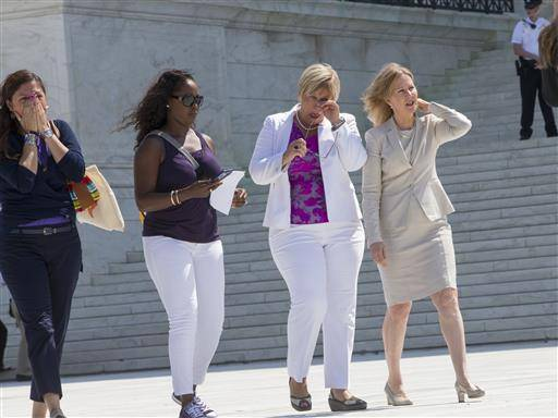 Amy Hagstrom Miller, second from right, founder of Whole Woman's Health, a Texas women's health clinic that provides abortions, leaves the Supreme Court in Washington, Monday, June 27, 2016, with Center for Reproductive Rights President Nancy Northup, far right, as the justices struck down the strict Texas anti-abortion restriction law known as HB2. The justices voted 5-3 in favor of Texas clinics that had argued the regulations were a thinly veiled attempt to make it harder for women to get an abortion in the nation's second-most populous state. The case is Whole Woman's Health v. Hellerstedt.