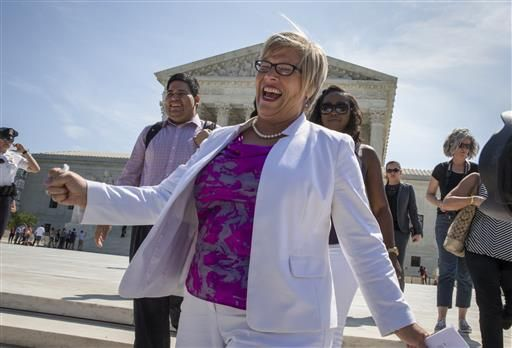 Amy Hagstrom Miller, founder of Whole Woman's Health, a Texas women's health clinic that provides abortions, rejoices as she leaves the Supreme Court in Washington, Monday, June 27, 2016, as the justices struck down the strict Texas anti-abortion restriction law known as HB2. The justices voted 5-3 in favor of Texas clinics that had argued the regulations were a thinly veiled attempt to make it harder for women to get an abortion in the nation's second-most populous state. The case is Whole Woman's Health v. Hellerstedt.