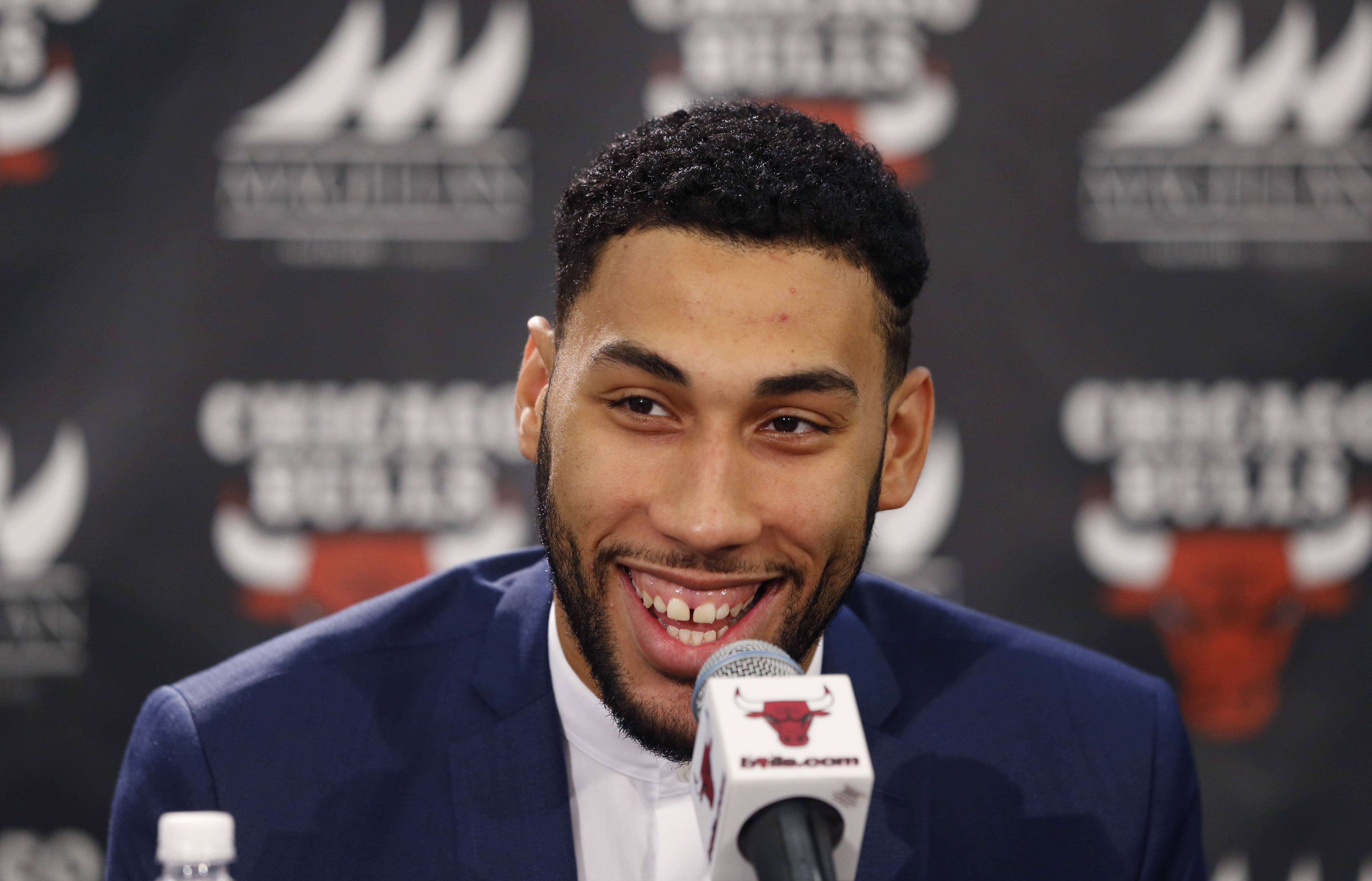 Chicago Bulls' first round draft pick Denzel Valentine, from Michigan State University, smiles during an NBA basketball news conference where the team introduced him Monday, June 27, 2016, in Chicago. (AP Photo/Charles Rex Arbogast)