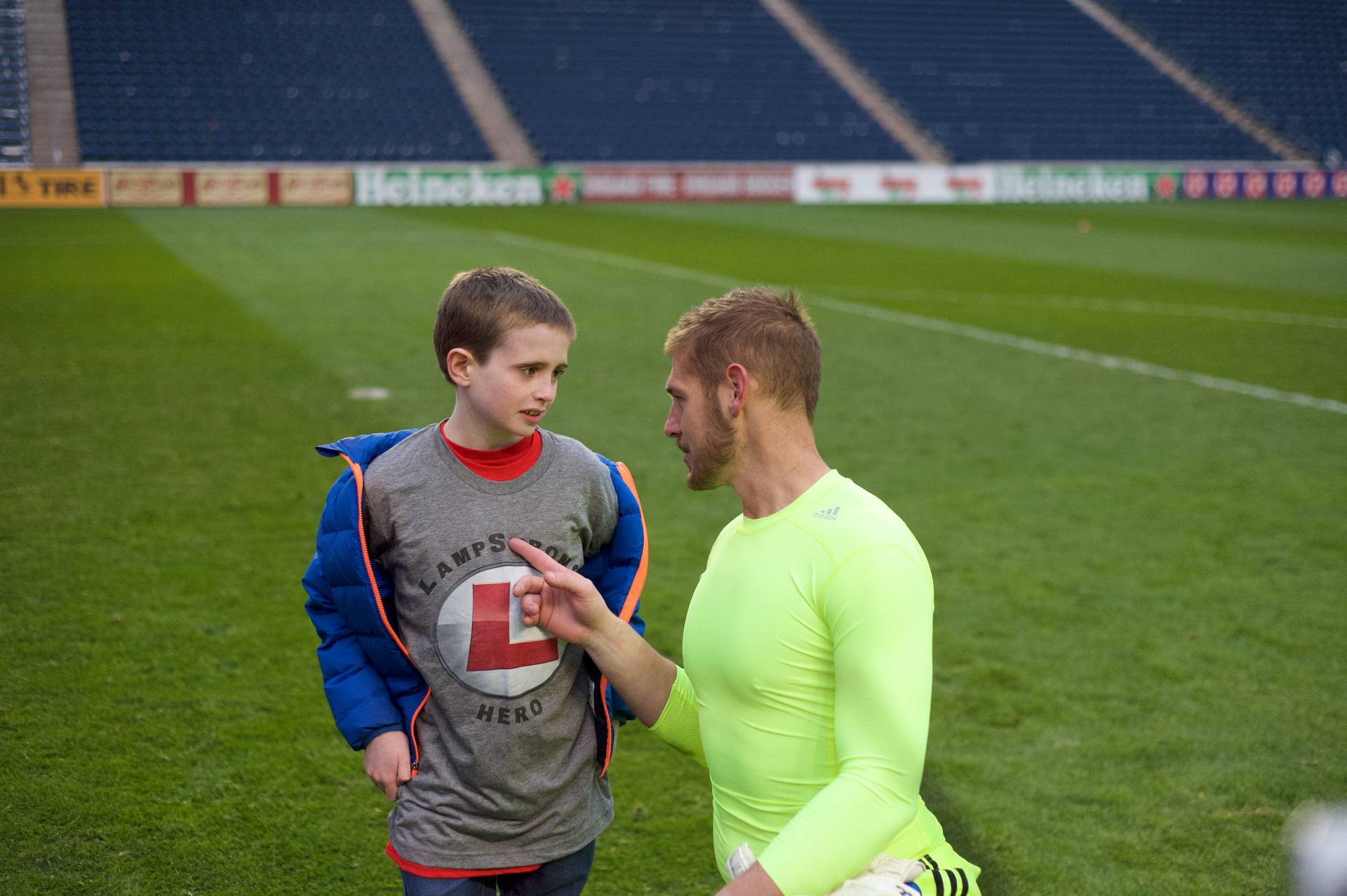 Chicago Fire goalkeeper Matt Lampson meets with a young cancer patient, Ryan, who was Lampson's guest at a recent soccer game.