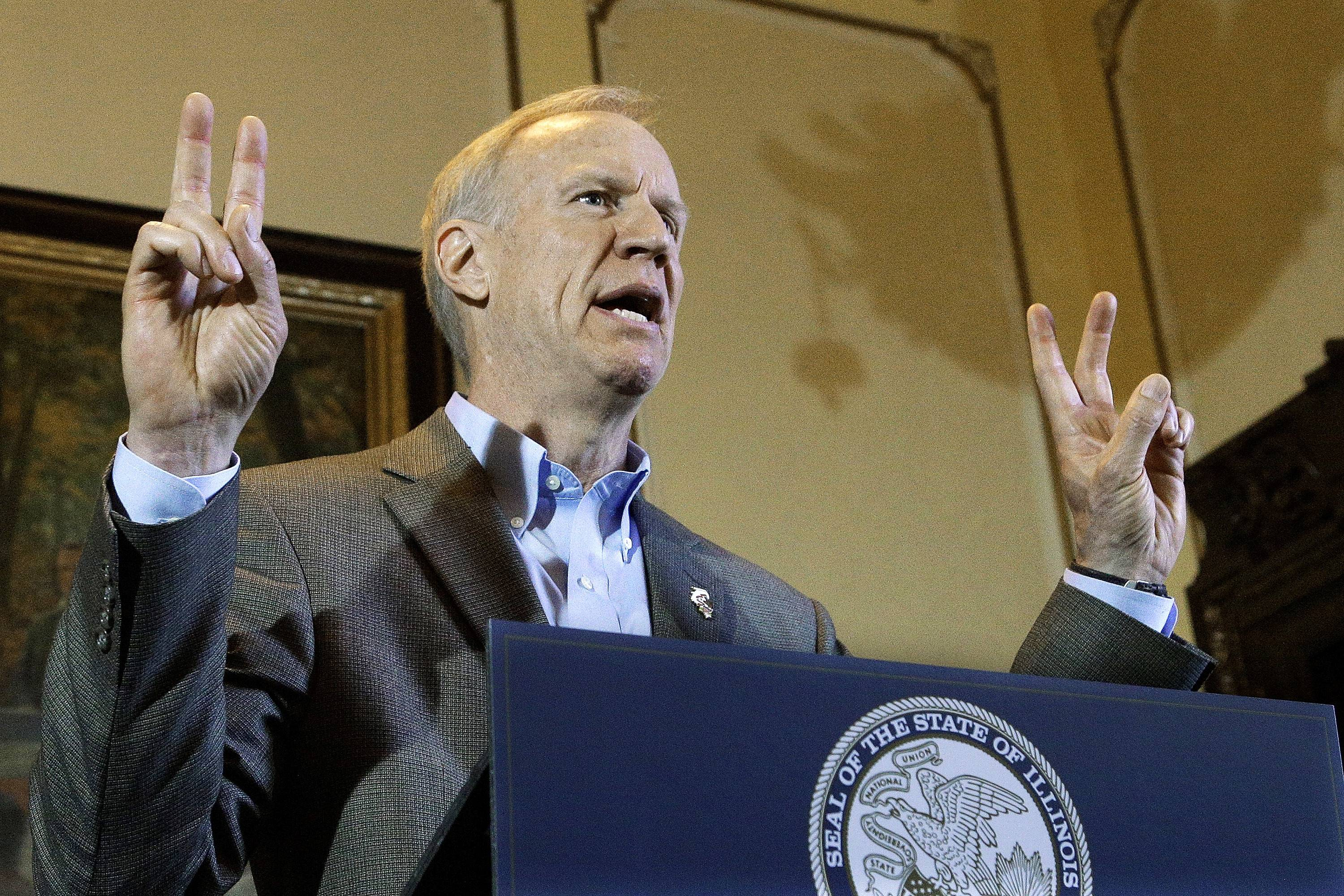 Illinois Gov. Bruce Rauner speaks to reporters Monday about the state budget and education funding in his office at the Illinois State Capitol in Springfield.