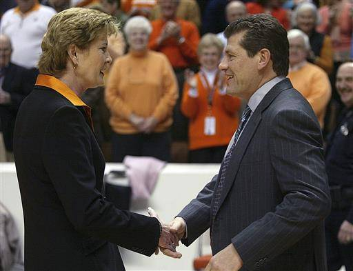 FILE - In this Jan. 7, 2006, file photo, Tennessee coach Pat Summitt, left, shakes hand with Connecticut coach Geno Auriemma before a women's college basketball game in Knoxville, Tenn. The update on Pat Summitt's health caught Geno Auriemma by surprise. It's simply the news nobody wanted to hear, especially her former rival who built UConn trying to model off her success coaching Tennessee.(AP Photo/Wade Payne, File)
