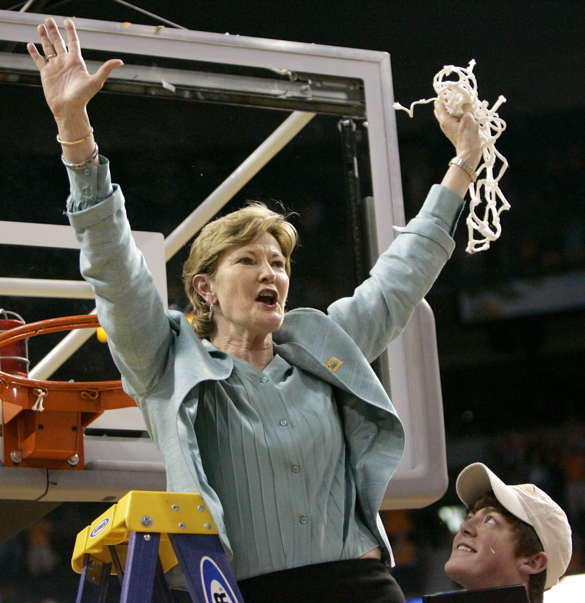 FILE — In this April 8, 2008, file photo, Tennessee coach Pat Summitt holds up the net as her son, Tyler, looks on after Tennessee beat Stanford 64-48 to win its eighth national women's basketball championship, at the NCAA women's basketball tournament Final Four in Tampa, Fla. Summitt, the winningest coach in Division I college basketball history who uplifted the women's game from obscurity to national prominence during her career at Tennessee, died Tuesday morning, June 28, 2016. She was 64. (AP Photo/Gerry Broome, File)