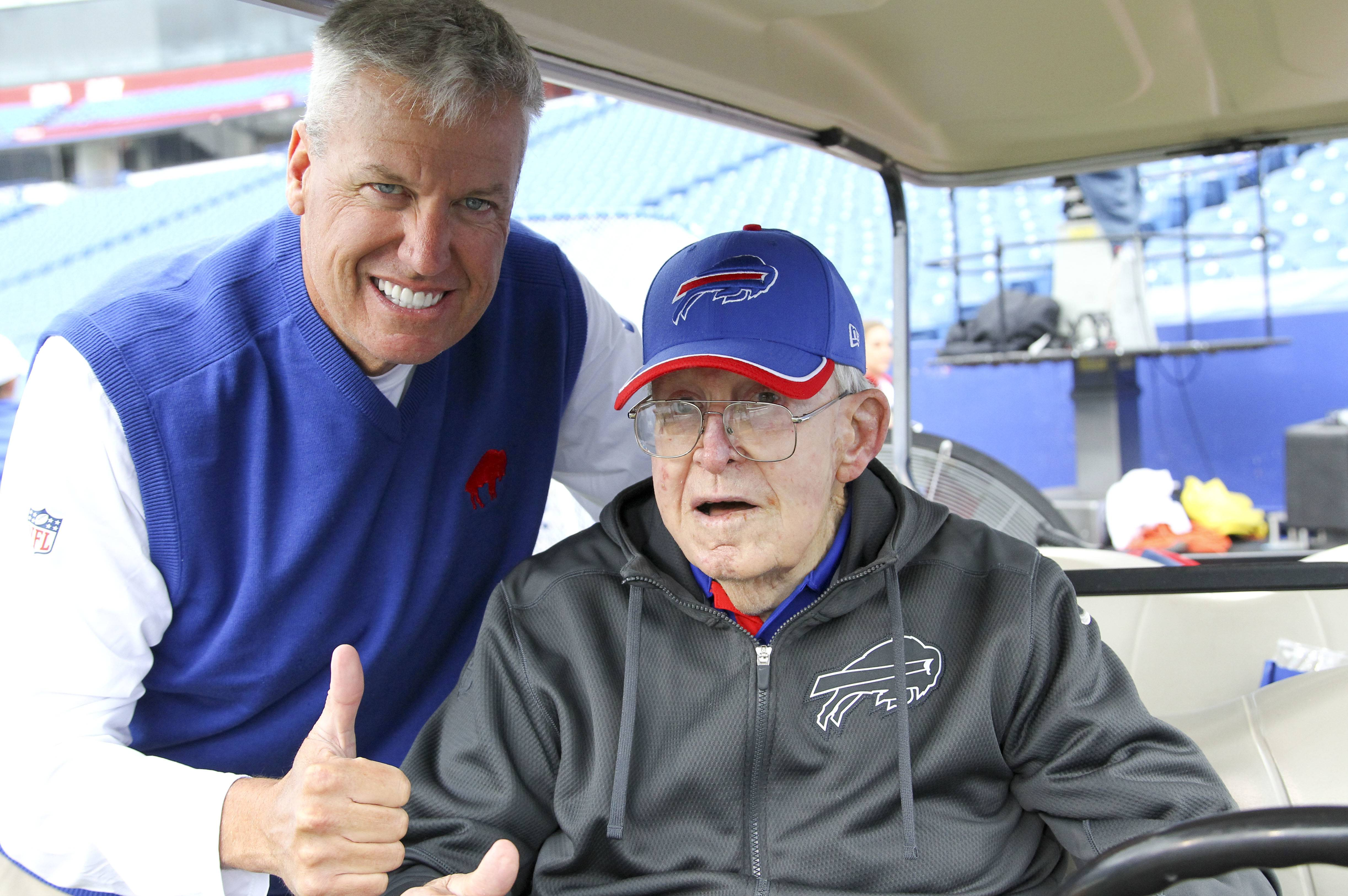FILE - In this Sept. 13, 2015, file photo, Buffalo Bills head coach Rex Ryan, left, visits with his father Buddy Ryan before an NFL football game against the Indianapolis Colts in Orchard Park, N.Y. Buddy Ryan, who coached two defenses that won Super Bowl titles and whose twin sons Rex and Rob have been successful NFL coaches, died Tuesday, June 28, 2016. He was 82. (AP Photo/Bill Wippert, File)