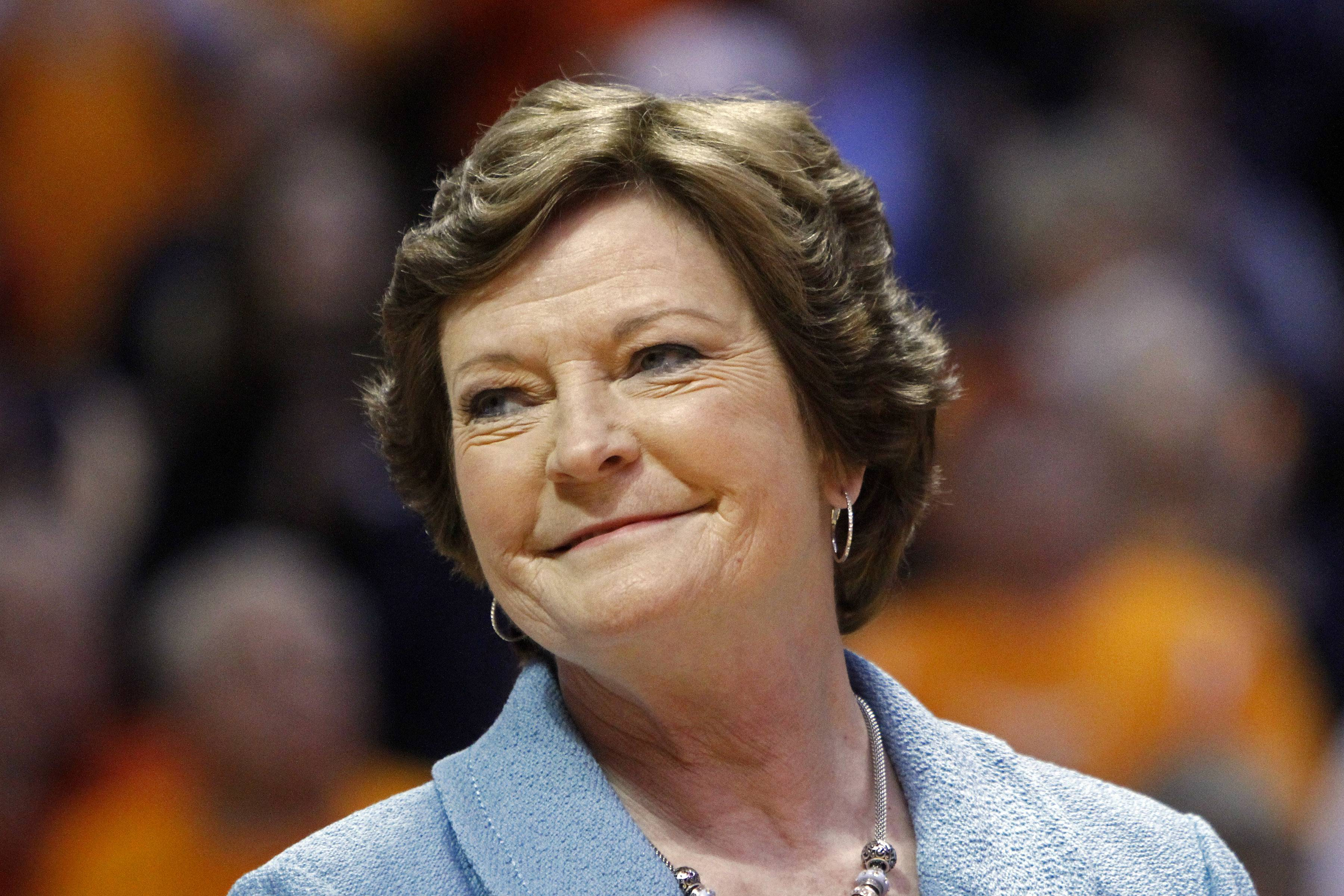 FILE - In this Jan. 28, 2013, file photo, former Tennessee women's basketball coach Pat Summitt smiles as a banner is raised in her honor before the team's NCAA college basketball game against Notre Dame in Knoxville, Tenn. Summitt, the winningest coach in Division I college basketball history who boosted women's game, has died at 64. (AP Photo/Wade Payne, File)